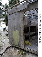 Wooden Beach Hut - An old and run-down wooden beach hut next...