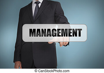 Businessman selecting the word management written on white...