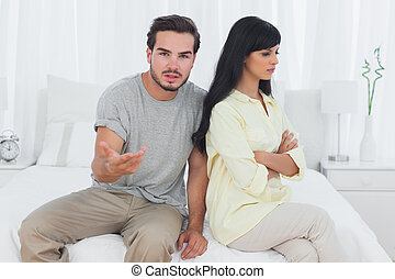 Woman sulking and her boyfriend doesnt know what to do in...