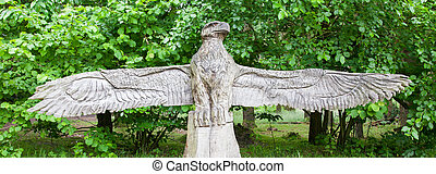 Wood craft of a eagle on top of a bench