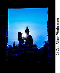 Silhouette of buddha and pagoda after sunset, wat Phra sri...