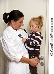 Doctor examines a child in surgery - Pediatrician...