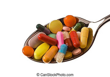 Tablets and medicines to health - Spoon on a lie tablets