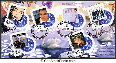 FINLAND - CIRCA 2012: A stamp printed in Finland shows series on Finnish music has reached the 1990's, circa 2012