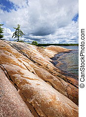 Rocky shore in Georgian Bay - Smooth rocky lake shore of...