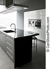 Kitchen counter - Interior of white kitchen with big counter...