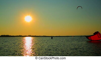 Kiteboarding - Practicing kiteboarding on a summer evening