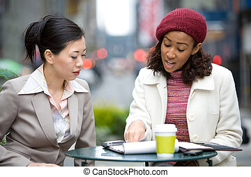 Business Meeting in the City - Two business women having a...