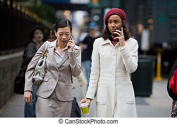 Mobile Business Women - Two business women having...