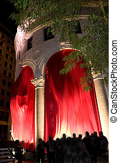 City Night Life - Classic architecture with flowing red...