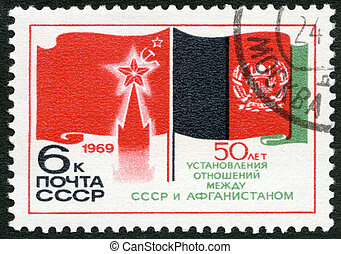USSR - CIRCA 1969: A stamp printed in USSR shows flags of...