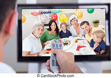 Man changing television channel through remote - Close up of...