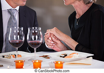 Affectionate Couple In Restaurant - Romantic Couple Having...