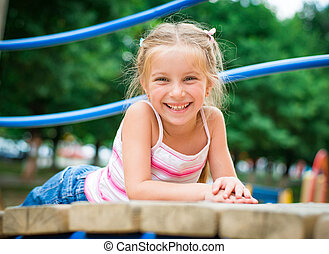 little girl on playground - cute smiling little girl on a...