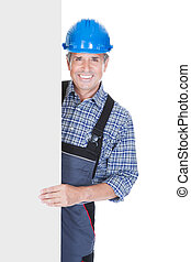 Happy Worker Pointing On Placard - Happy Worker Over White...