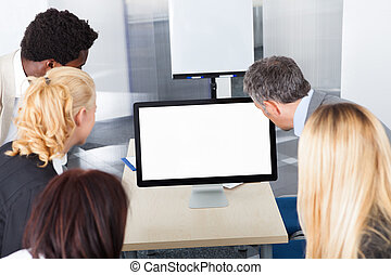 Business Colleagues Looking At Monitor
