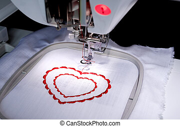 Sewing-machine - The sewing-machine costs on a table and is...