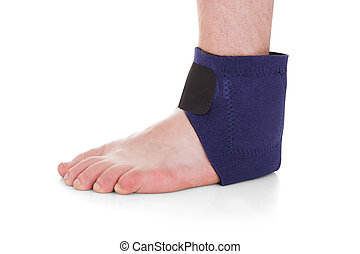 Close-up Of Man Wearing Brace On Foot - Close-up Of A Man...