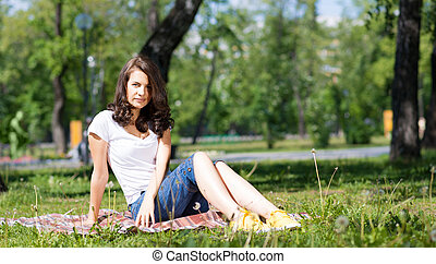 young woman in the summer park
