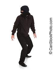 bandido, en, negro, máscara, Mirar, espalda