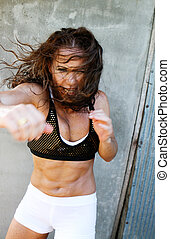 Woman working out. - Attractive female working out during a...
