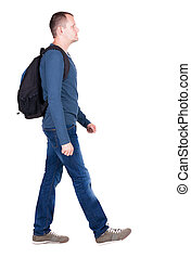 back view of walking man with backpack brunette guy in...