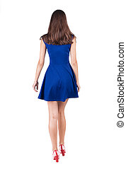 back view of walking woman in dress . going gir in motion....