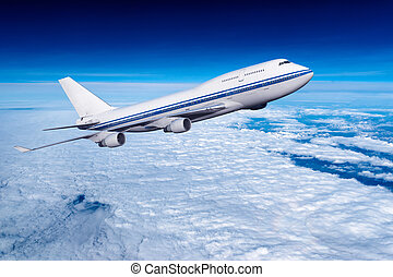 passenger airplane in the clouds. travel by air transport....