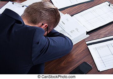 Businessman Sleeping In Office - Portrait Of Stressed...