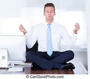 Businessman Practicing Yoga - Young Businessman Sitting On...