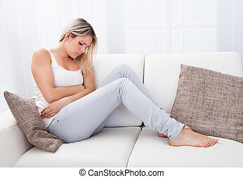 Woman with stomach ache - Portrait of woman with stomach...