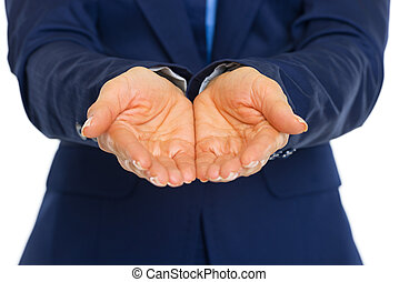 Closeup on business woman presenting something on empty palm