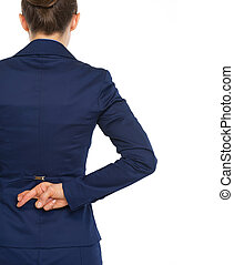 Business woman holding crossed fingers behind back rear view...