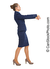 Full length portrait of business woman walking like zombie