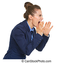 Business woman shouting through megaphone shaped hands