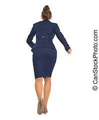 Full length portrait of business woman running straight ....