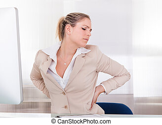 Young Businesswoman Suffering From Back Pain