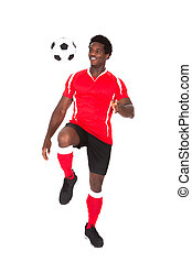 Soccer Player Kicking Football - Portrait Of African Soccer...