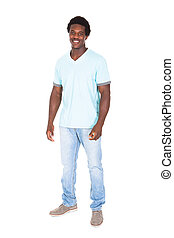 Casual Young African Man Posing In Front Of Camera