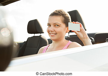 Woman Showing Driving License - Happy Young Woman In Car...