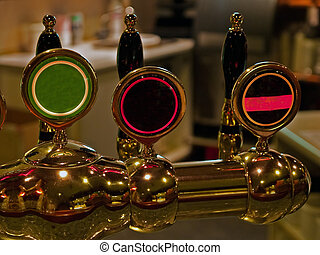 Beer taps in a pub bar - Beer taps spigot in a pub bar...