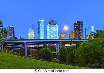 view on downtown Houston in late afternoon from the bayou -...