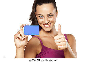 blank credit card - smiling pretty girl holding her credit...