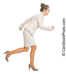 Full length portrait of business woman running sideways