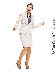 Full length portrait of happy business woman dancing