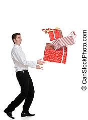teen boy dropping christmas presents on white