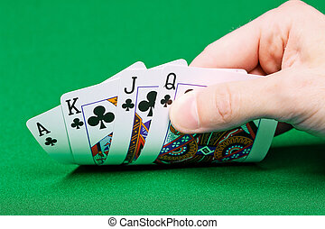 four cards in the player's hand on green table