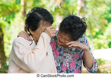 Sad senior Asian women in grieving the loss of a loved one...