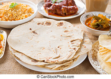 Chapatti roti, curry chicken, biryani rice, salad, masala...