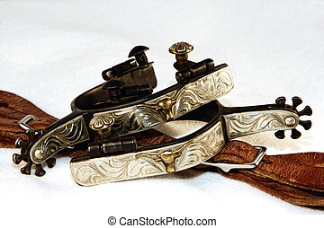 Western Fancy Spurs and Leathers - A pair of fancy, engraved...